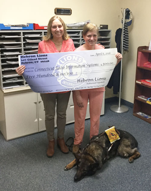 Eillen Akers and Brownie drop off a contribution from the Hebron Lions